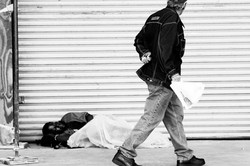Walking by Woman Asleep on Sidewalk