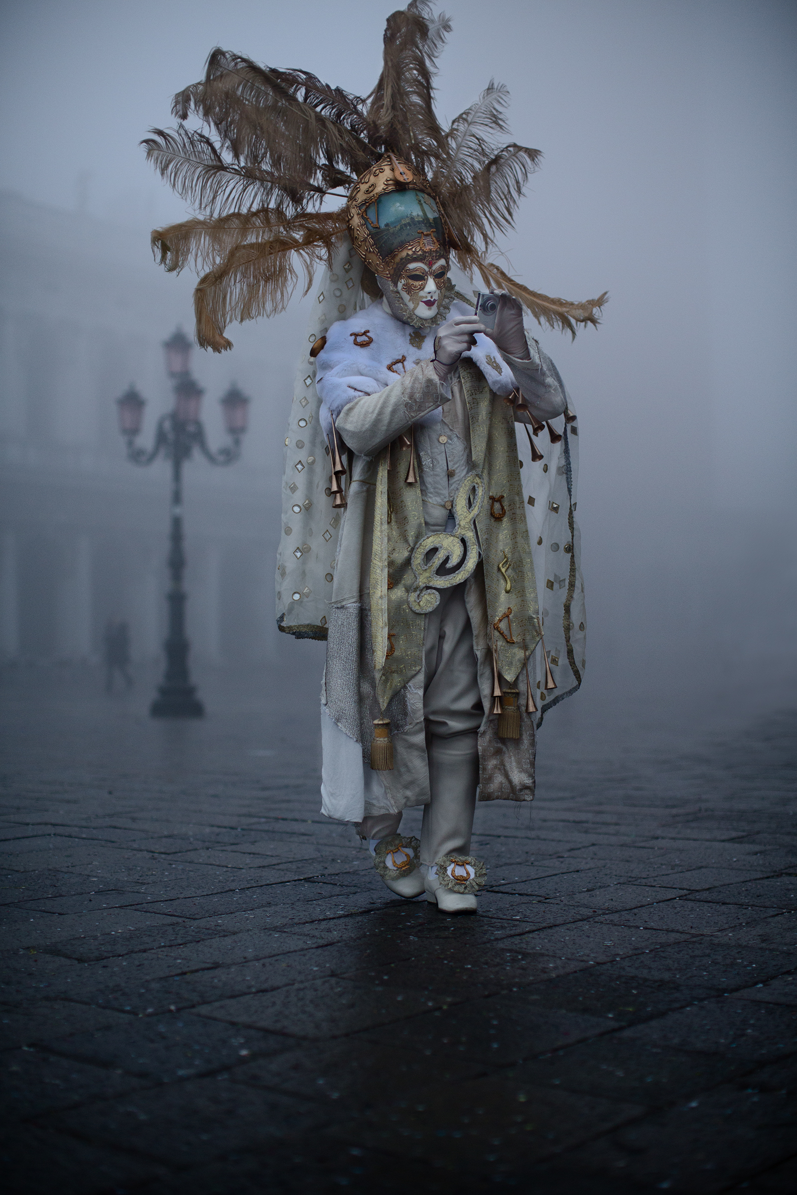 Performer with Feathers in the Fog