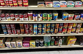 A shelf of canned foods at AM Stop Food Mart