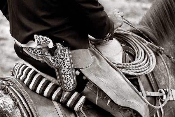 Saddle, rope, and pistol of a mounted rider at the Fiesta Charreada.