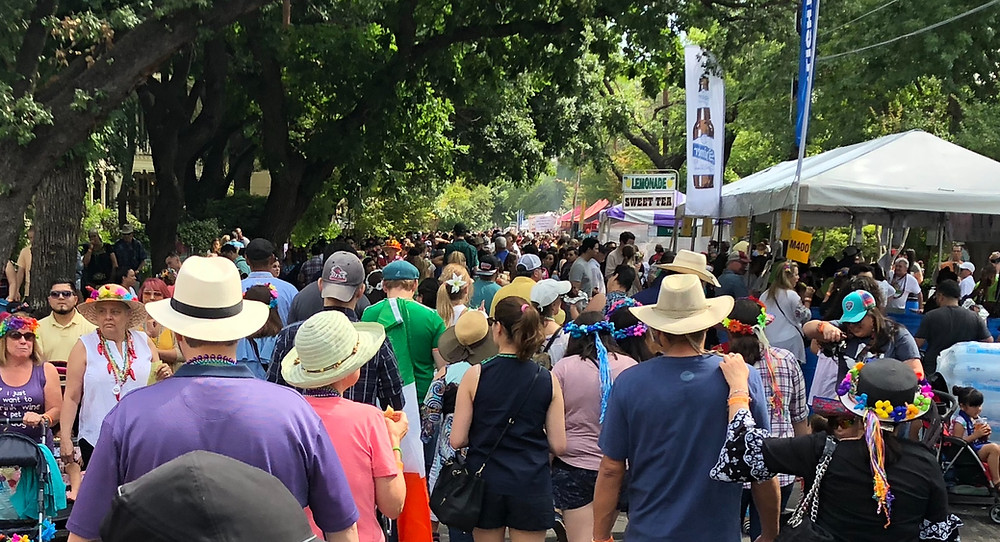 People crowd the street at the King William Fair
