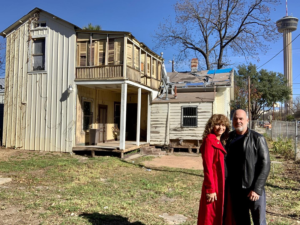 Steve and Belinda Yndo stand in front of the Lavaca home they are renovating