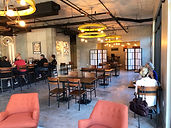 The interior of Re:Rooted is bright, open, and high-ceilinged.