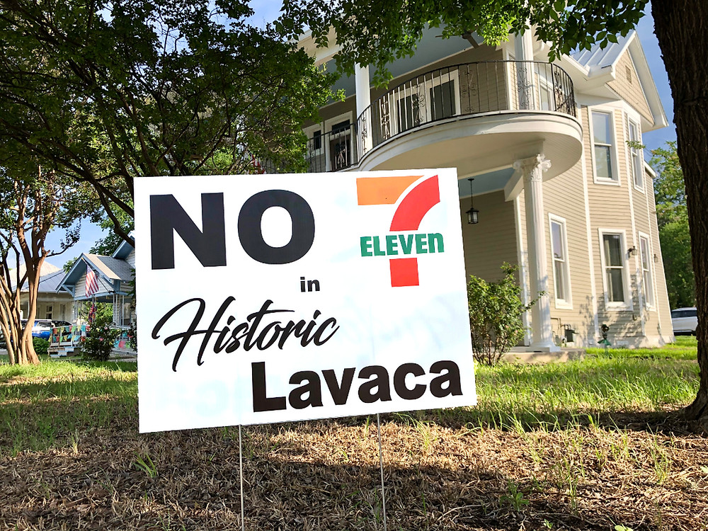 A yard sign saying 'No 7-11 in Historic Lavaca.'