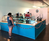 Gustavo Garcia serves a customer at Oh Yeah Cakes