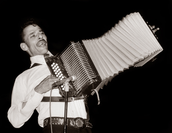 Accordionist 'Santiago' Jimenez performs at the Guadalupe Cultural Arts Center's annual Conjunto Tejano music festival in the early 1980s. Shot by Al Rendon in black and white.