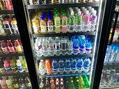A cooler of cold beverages at AM Stop Food Mart
