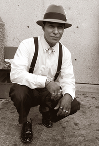 This photo of a young man, nattily dressed and crouching, was taken in Market Square.
