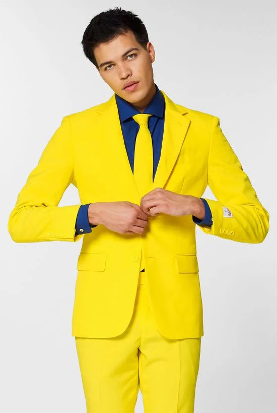 Model wears a yellow suit and navy shirt