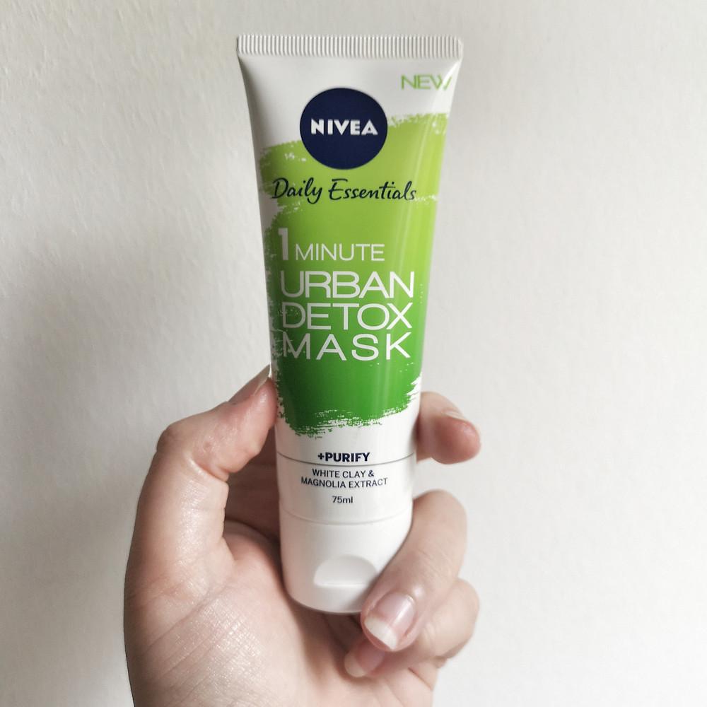 Hand holding Nivea Daily Essentials 1 Minute Urban Detox Mask