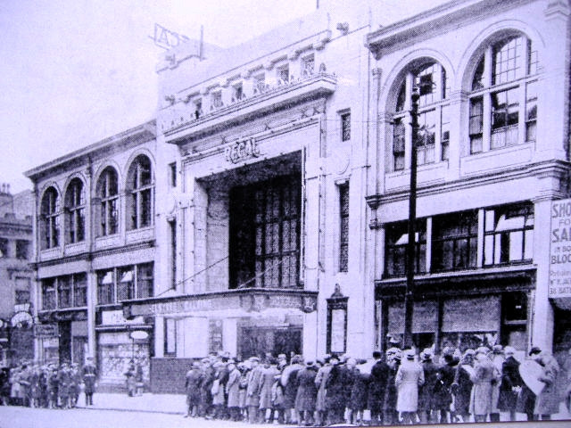 Black and white image of the ABC with people crowded outside in queues