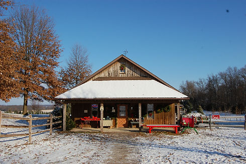 Snow-covered front of the shop at Otterdale View Christmas Tree Farm.