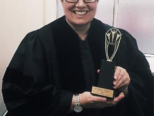 Kathleen receives award:Top of the Class