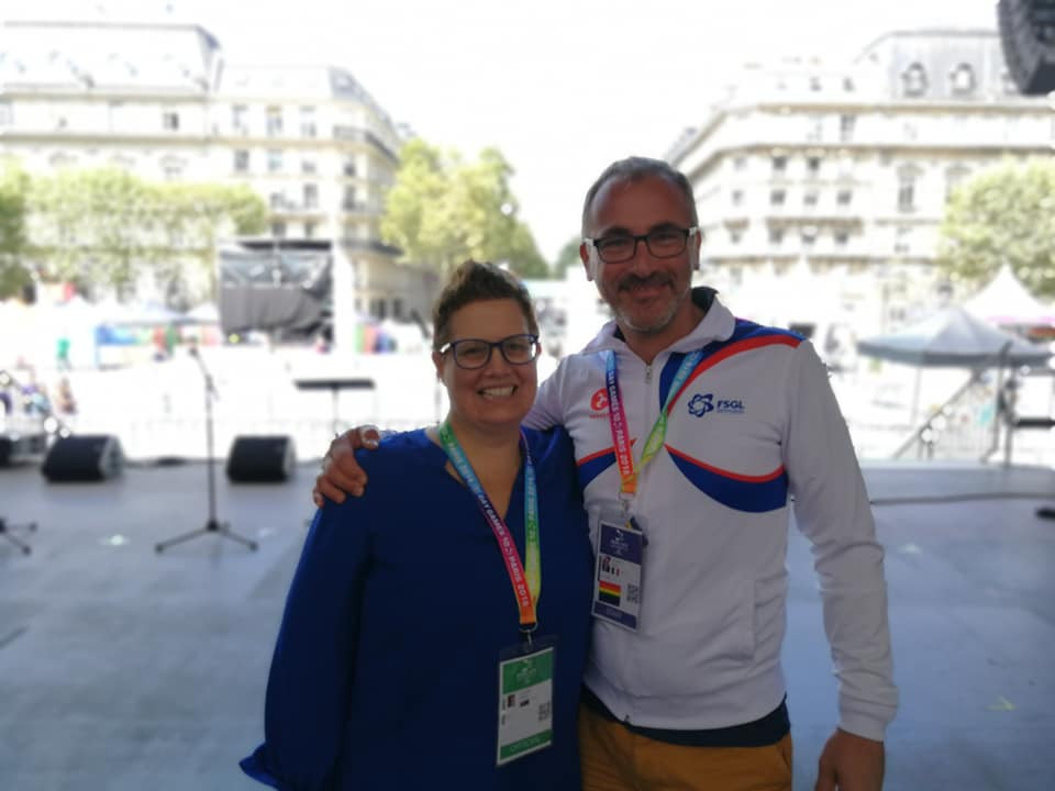 Kathleen with Laurent Stachnick (Director of Culture, Gay Games 10, Paris) on the Main Stage at the Gay Games Village, Hôtel de Ville.