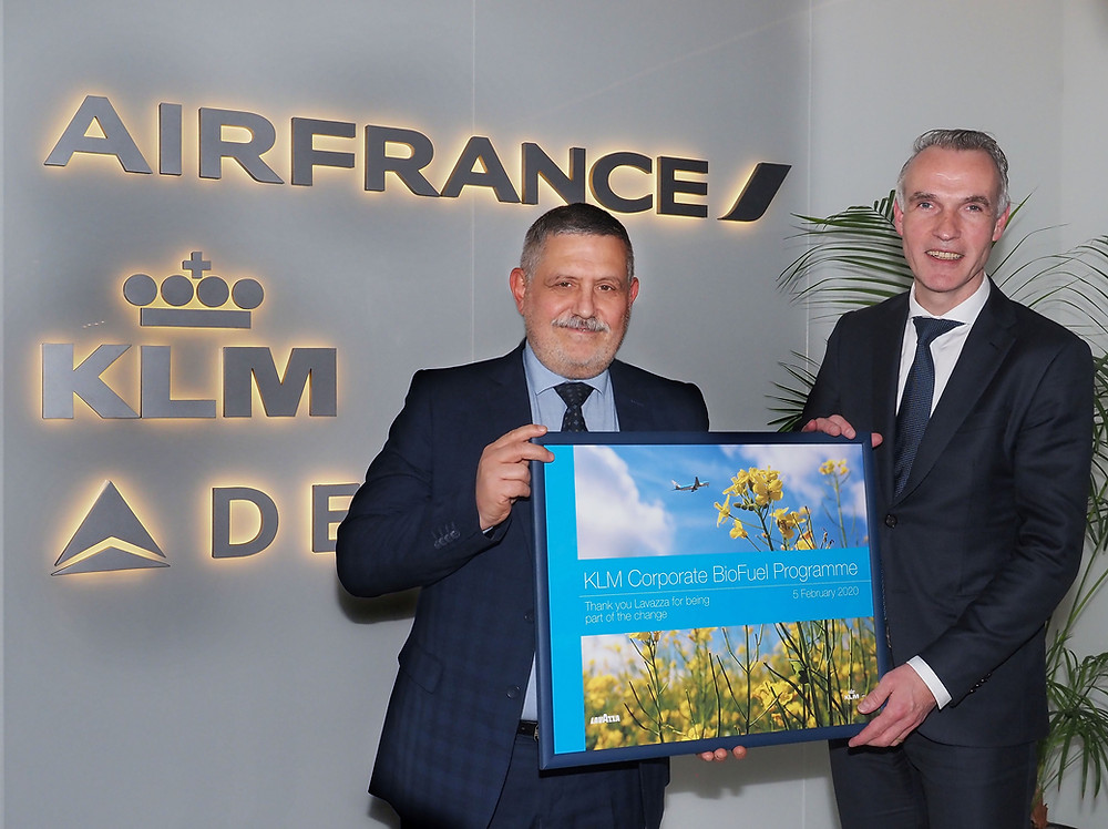 Executives from Lavazza and Air France-KLM pose with a plaque for KLM's corporate biofuel program.