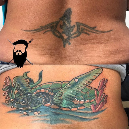 Covered an older dolphin and tribal tatt