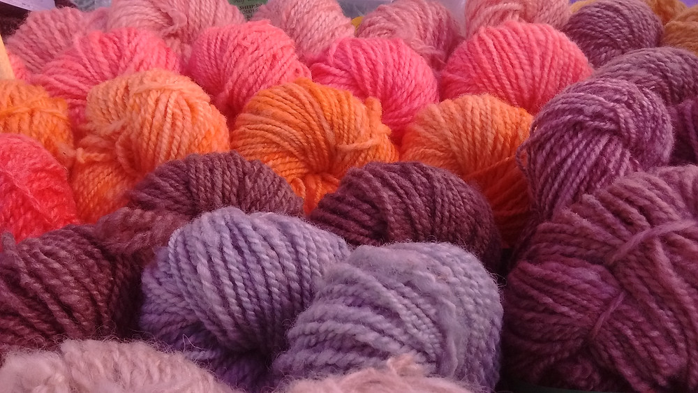 Colorful 100% Wheelspun Yarns produced by Wheely Wooly Farm Sheep