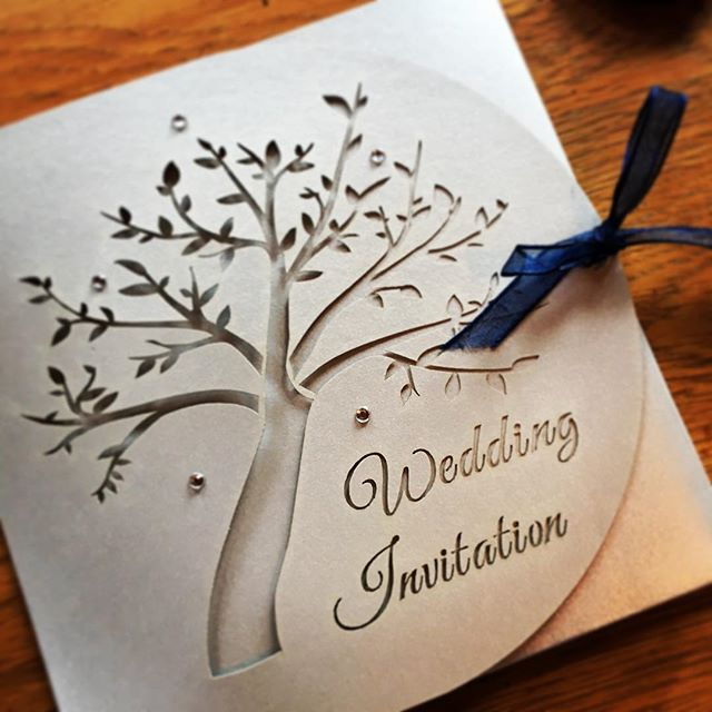 Finishing touches for this silver and navy delicate cut invite #weddinginvitations #wedding