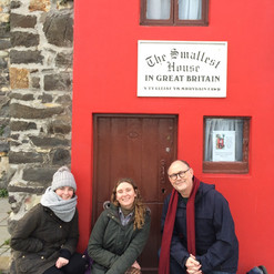 Taking a quick breather outside the Smallest House in Great Britain