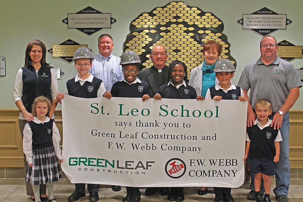 L to R: Liz Mason, Green Leaf; Andy McBeth, Green Leaf; Msgr Doran, St. Leo Parish; Carolyn Polselli, St. Leo School; Tom Dube, Green Leaf