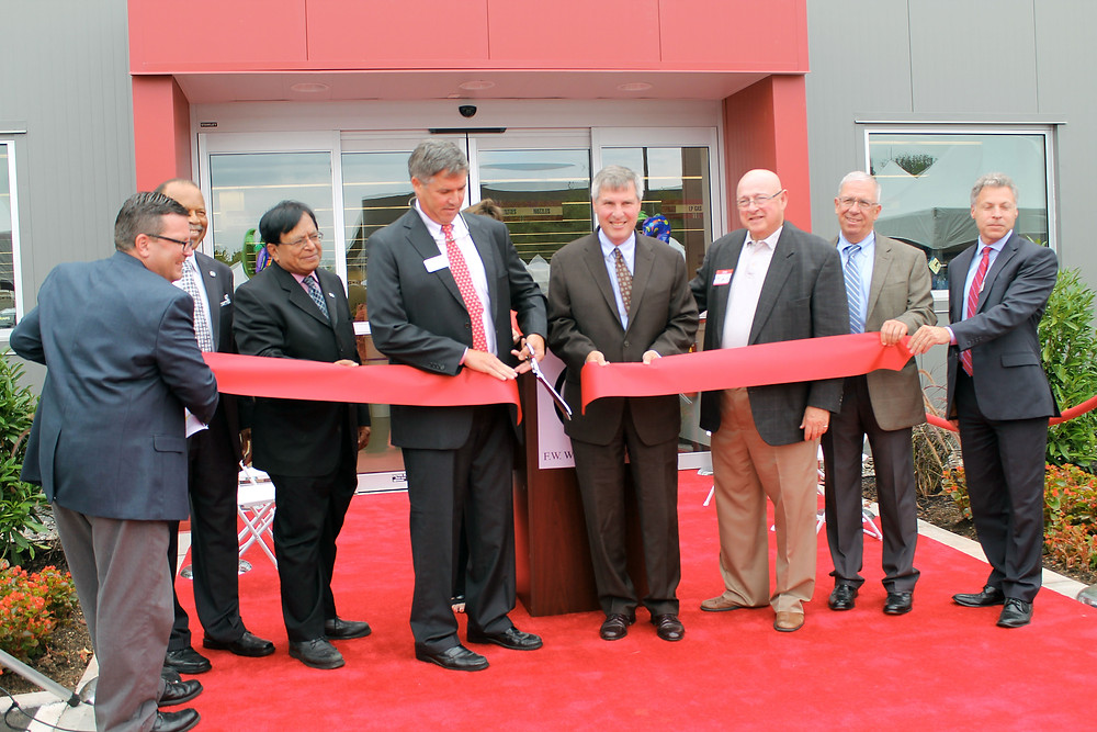 F.W. Webb Company President Jeff Pope cuts the ceremonial ribbon with the help of Piscataway Township Mayor Brian Wahler (right of Pope) and representatives from the state of New Jersey, township of Piscataway, and F.W. Webb.