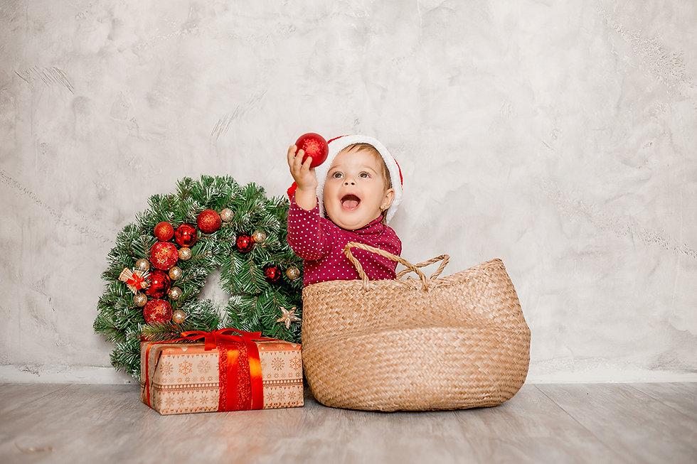 sweet-baby-santa-sits-in-a-wicker-basket