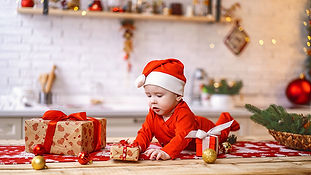 baby-with-gift-boxes-on-the-table-with-c