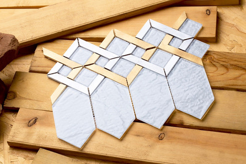 Mirrella Tile,Super white glass coupled with silver and gold aluminum.