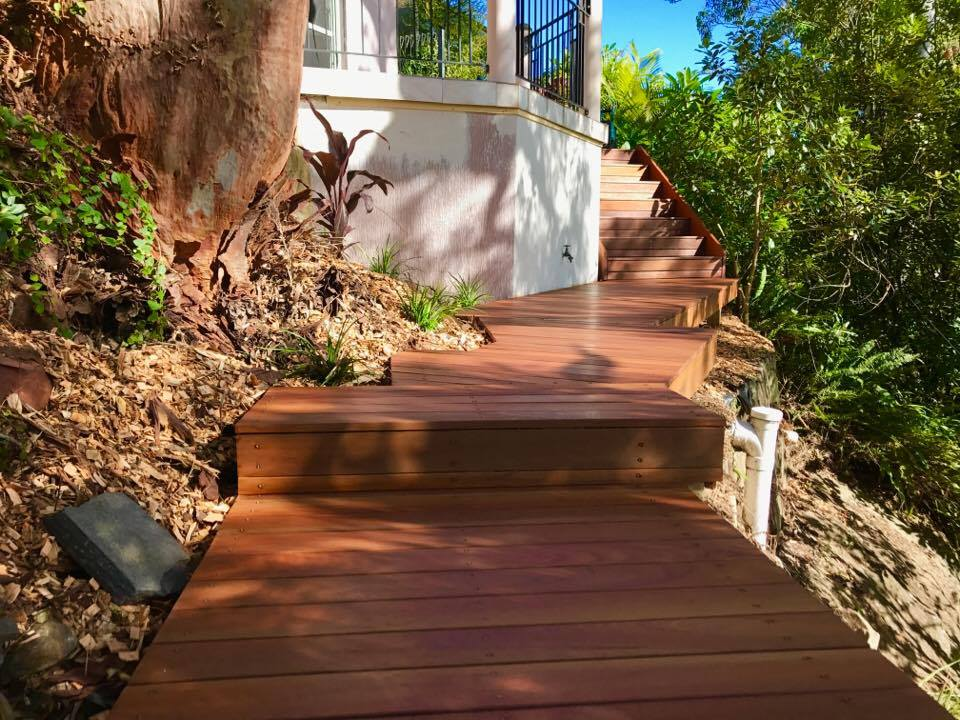 Decking/stairs on slopping block for easy access to pool