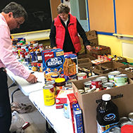 volunteers counting food donations