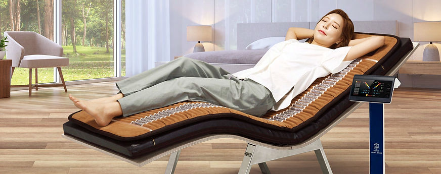 Asian woman enjoying her time lying on the infrared BioMat and BioAcoustic Sound Therapy mat