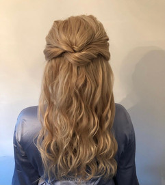 half up half down hairstyle with waves