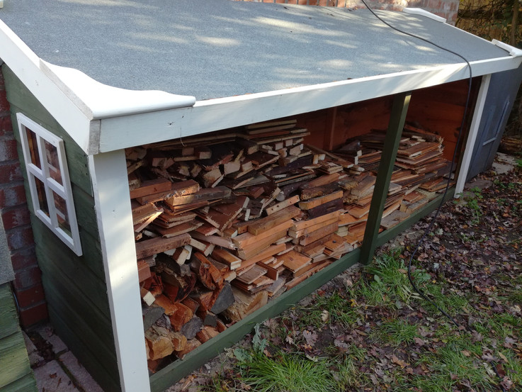 Up-Cycled shed turned into a log store