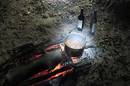 Open fire cooking on our overnight kayak bivy in the Lake District