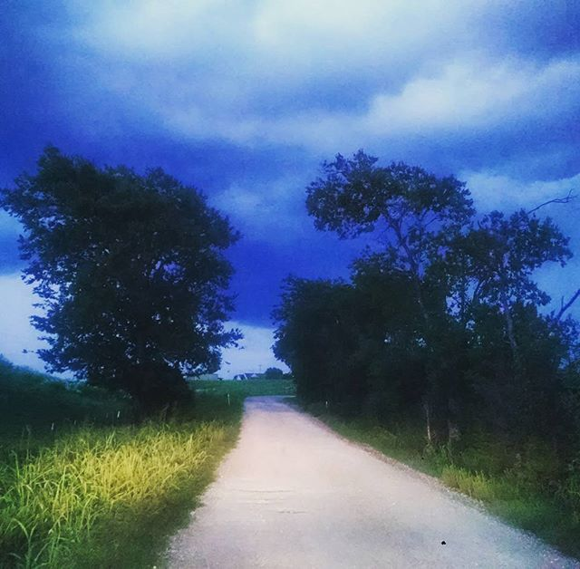 Country road with a storm blowin' in