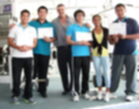Chris and Narng with students and their certificates_edited.jpg