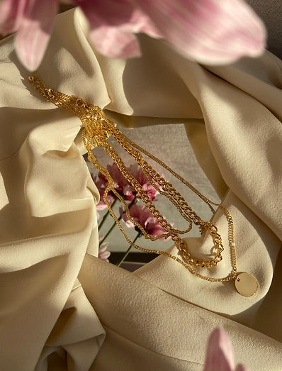 fashion garment with flowers and gold accessory jewelry