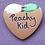 Thumbnail: Peachy Kid Heart Shaped Badge