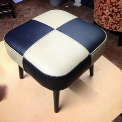 Black and white leather foot stool