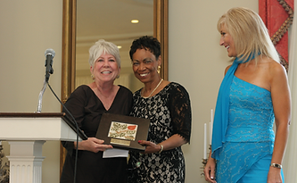 Moe Rause, Margo Spence and Liz Bonis at First Step Home'sRose Award Gala