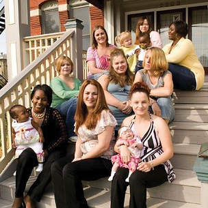 First Step Home clients with their children on front steps of 2203 Fulton Ave.