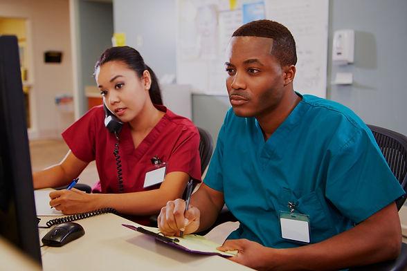 Male And Female Nurse Working At Nurses Station_edited_edited.jpg