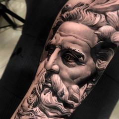 Statue tattoo