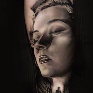 Womans portrait tattoo