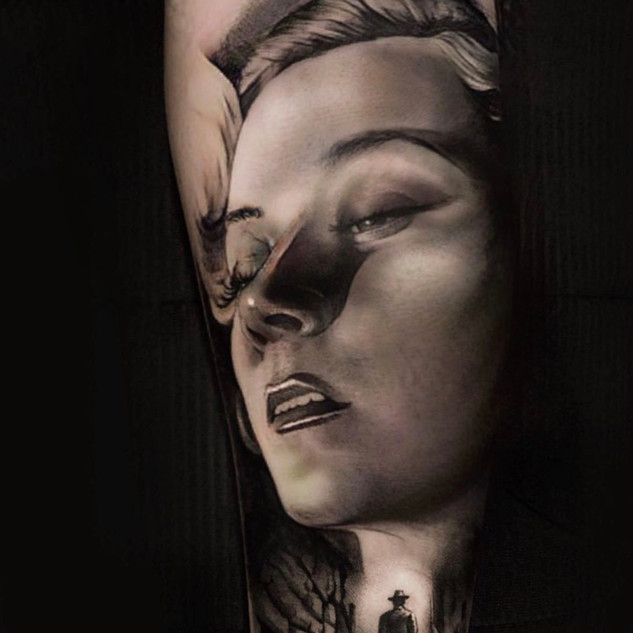 Womans portrait tattoo