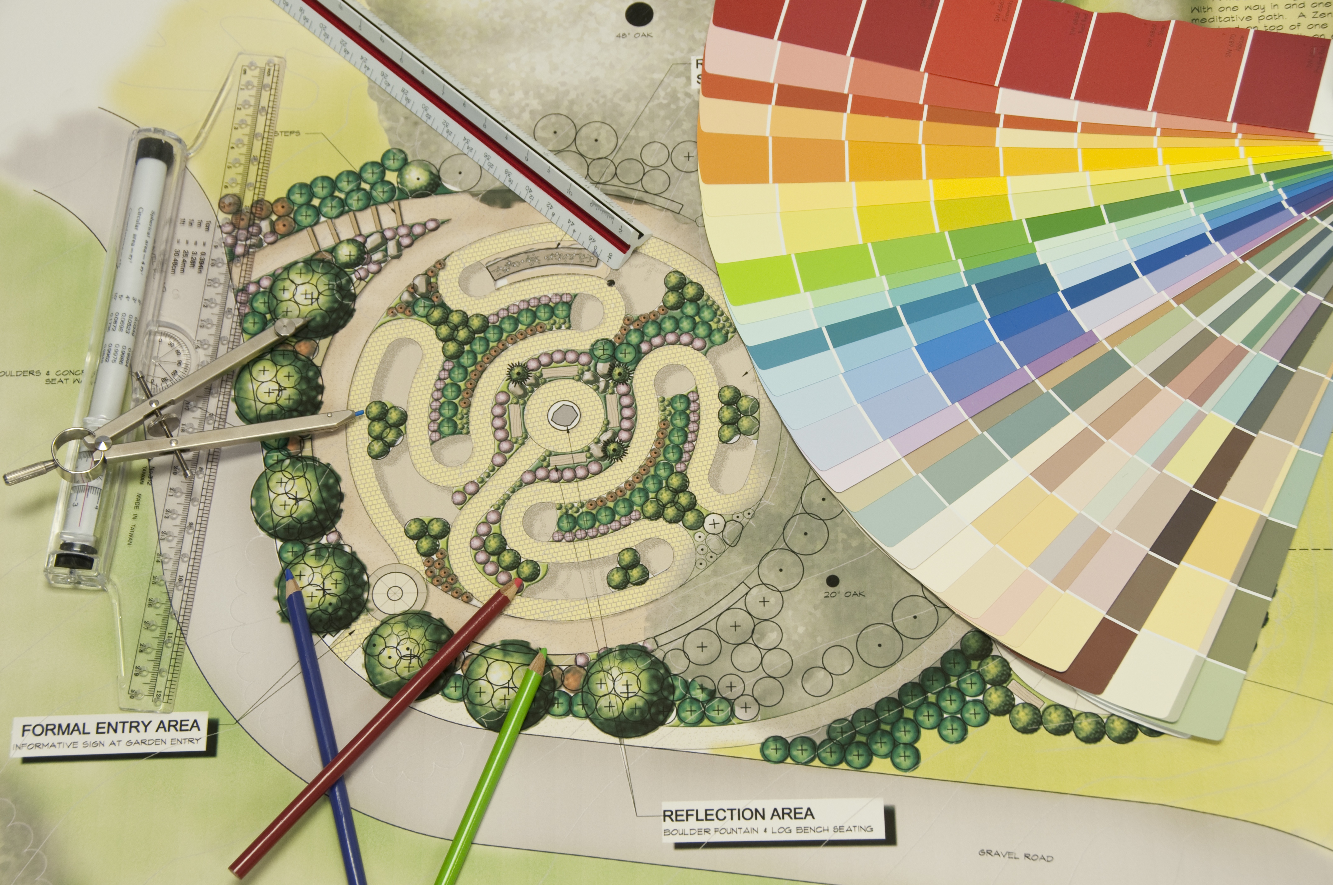 Labyrinth landscape design with a color wheel and drafting tools
