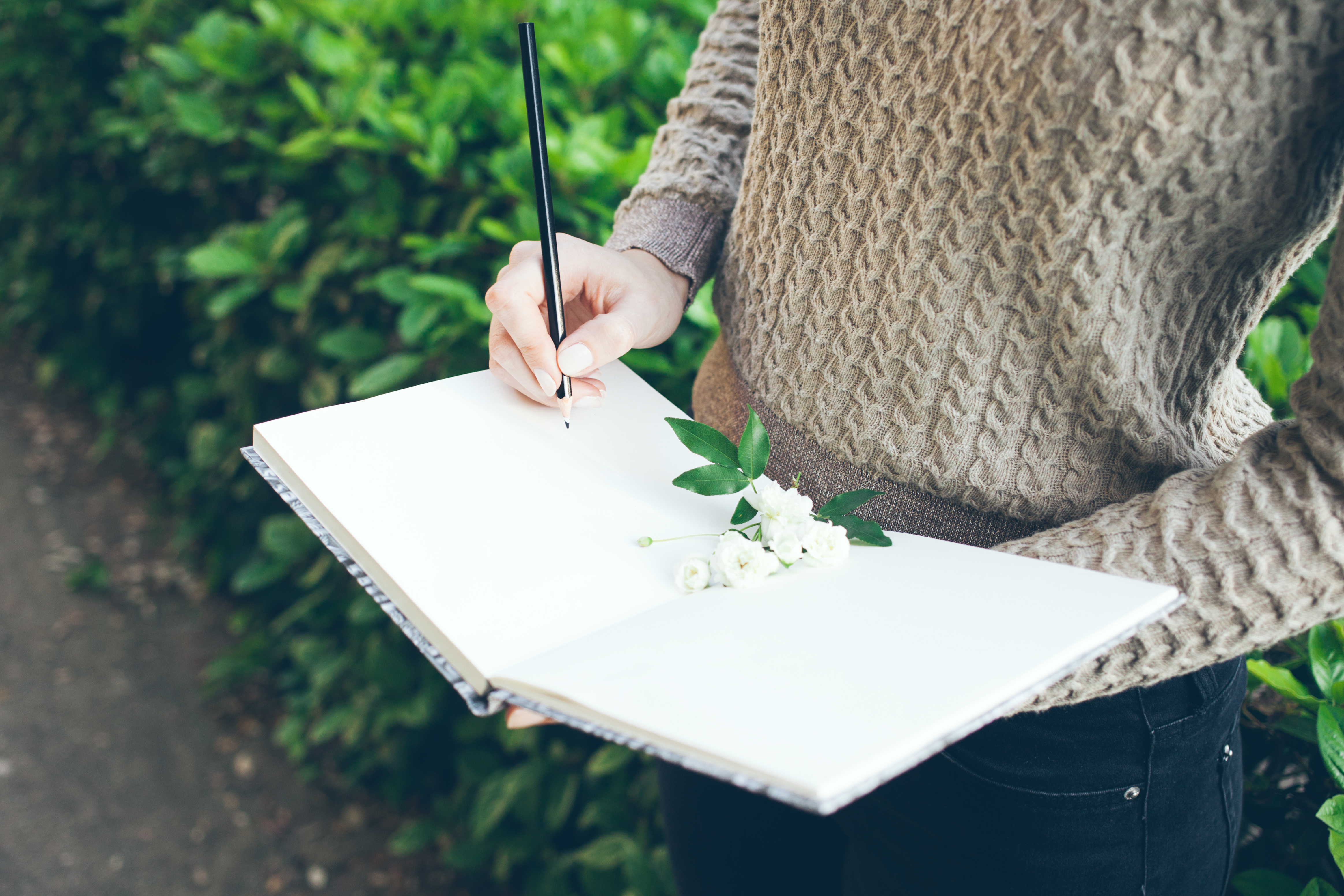 architect woman is planning new landscape project and drawing sketches an