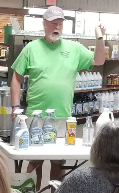 Tom shows customers how to use a toilet paper roll to prevent over-spray.