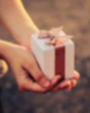 Girl hands holding a small gift wrapped