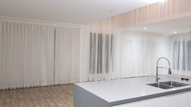Sheer curtains with roller blinds in liv